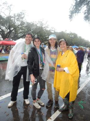 rainy weather doesn't stop people coming out to enjoy parade in New Orleans during Mardi Gras. Learn all the best tips for making your trip successful with this free guide!