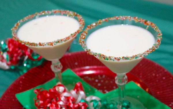 The bright fun Sugar Cookie Martini is deliciously creamy and tastes just like a sugar cookie! Wow your guests at your next holiday party with this easy dessert cocktail recipe!