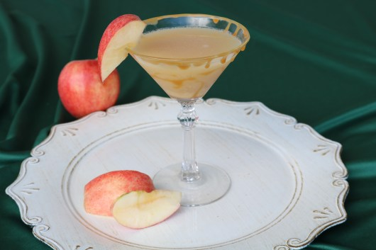 Salted caramel apple martini is a new favorite fall cocktail recipe! Drizzle some caramel sauce on the rim of the martini glass for the ultimate mouthwatering holiday treat!