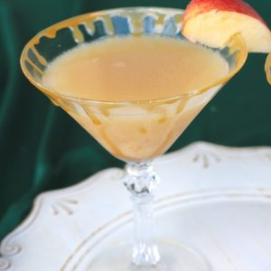 Salted caramel apple martini will be a hit at any holiday party! This holiday cocktail is perfect for sipping around the fireplace or at a holiday party with friends! Use this holiday drink recipe at your next party!