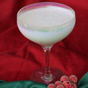 A delightful winter cocktail with malibu rum, creme de cacao and cream of coconut. Garnish with shredded coconut for the ultimate creamy holiday cocktail.