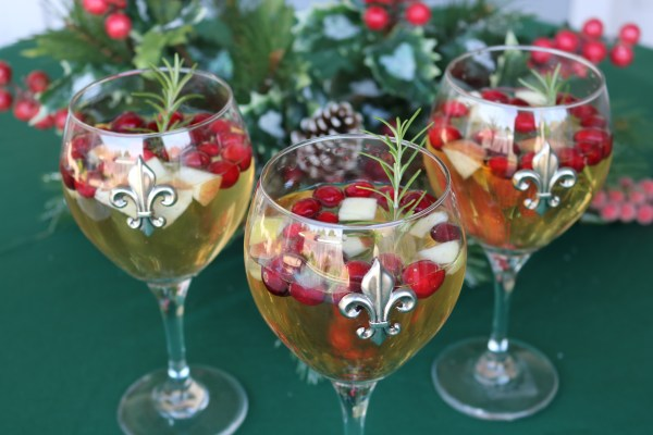 A simple sweet sangria made with a white wine, apple cider, brandy, and fresh fruit. A fantastic holiday cocktail to bring to any Christmas party.