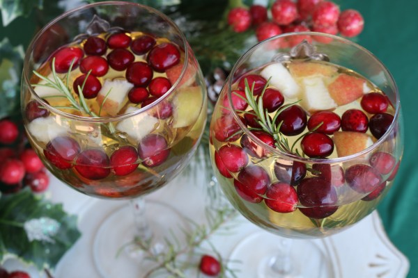 Spread Christmas cheer with this White Christmas Sangria. A sweet wine with brandy and apple cider and packed with fresh fruit for a delightful holiday drink!