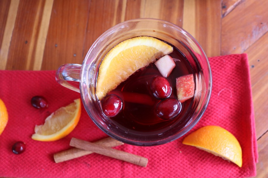 One of the easiest christmas cocktail recipes using your slow cooker! A warm delicious wine filled with fruits and spices! It's like christmas in a cup for all your friends!