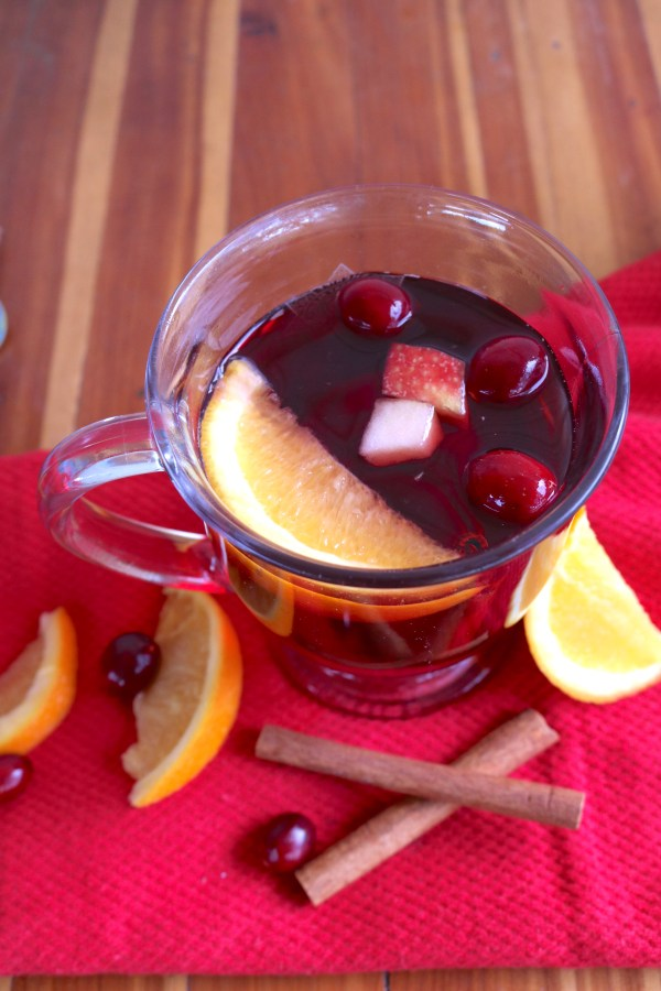 Spread Christmas cheer with a slow cooker mulled wine recipe! This cocktail recipe is full of fruits and spices that are so flavorful! It'll put a smile to all your party guests' faces.