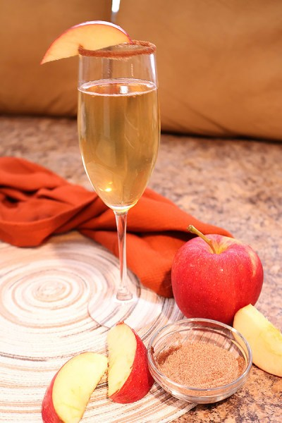 apple cider mimosas are made with just two ingredients to give you the perfect cold weather beverage. Light, refreshing and bubbly, it's sure to a be a hit at Christmas brunch!