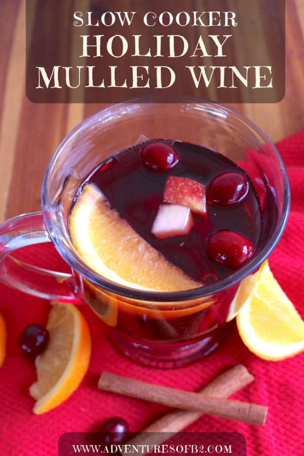 You can't go wrong with a holiday spiced mulled wine recipe especially in the crock pot! This cocktail is warm, flavorful and filled with fruit and spices. A tasty treat for all your holiday guests! #holidaycocktails #mulledwine #