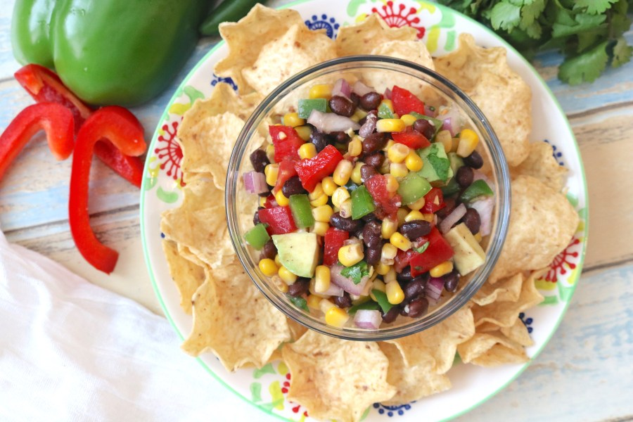 A fast, fresh, delicious corn and black bean salsa recipe! Perfect for bringing parties or eating it all by yourself at home! - Adventuresofb2.com