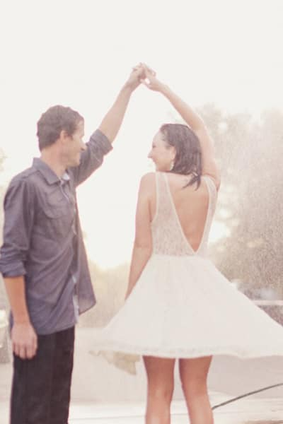 when rain is part of the fun for a date, dance in the rain! A fantastic rainy date idea that will have you and your partner full of laughs and memories! See more rainy day dates at adventuresofb2.com- photo by Alixann Loosie