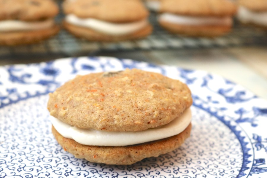 carrot cake whoopie pies are similar to oatmeal cream pies but better! these whoopee pies are made up of fluffy carrot cake cookies with luscious cream cheese filling in the middle. Delicious! - AdventuresofB2.com