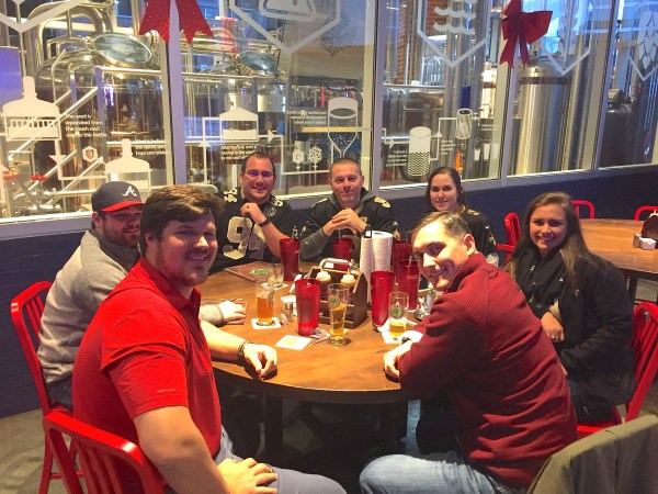 A group of Saints and Atlanta fans enjoying some food and beers at the terrapin taproom in Atlanta Georgia! One of the many great places to eat in Atlanta - Adventuresofb2.com
