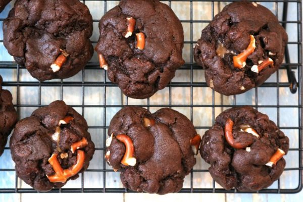 Chocolate salted caramel pretzel cookie is a soft rich chocolate cookie with chocolate chips and pretzel bits with a salted caramel filling. The greatest combination of sweet and salty in a cookie.- AdventuresofB2.com