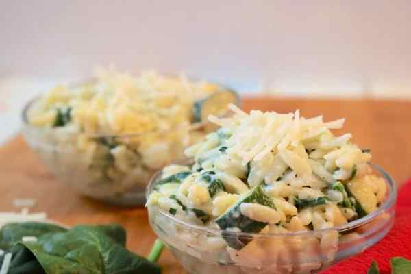 creamy parmesan orzo pasta is a light creamy pasta loaded with spinach and zucchini and sprinkled with cheese. A delightful pasta that compliments any meal.- Adventuresofb2.com