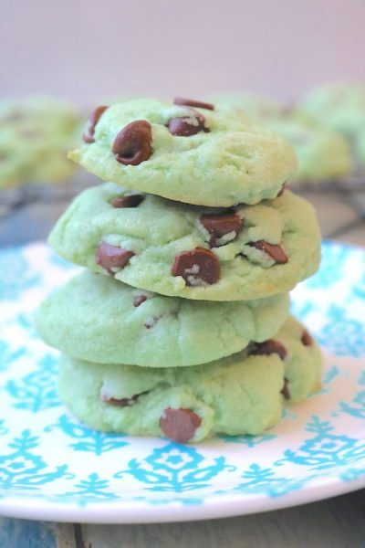 mint chocolate chip cookies are your classic favorite ice cream in a warm fluffy cookie. Peppermint dough swirled with chocolate chips in a festive green color. Perfect for summer celebrations! - Adventuresofb2.com