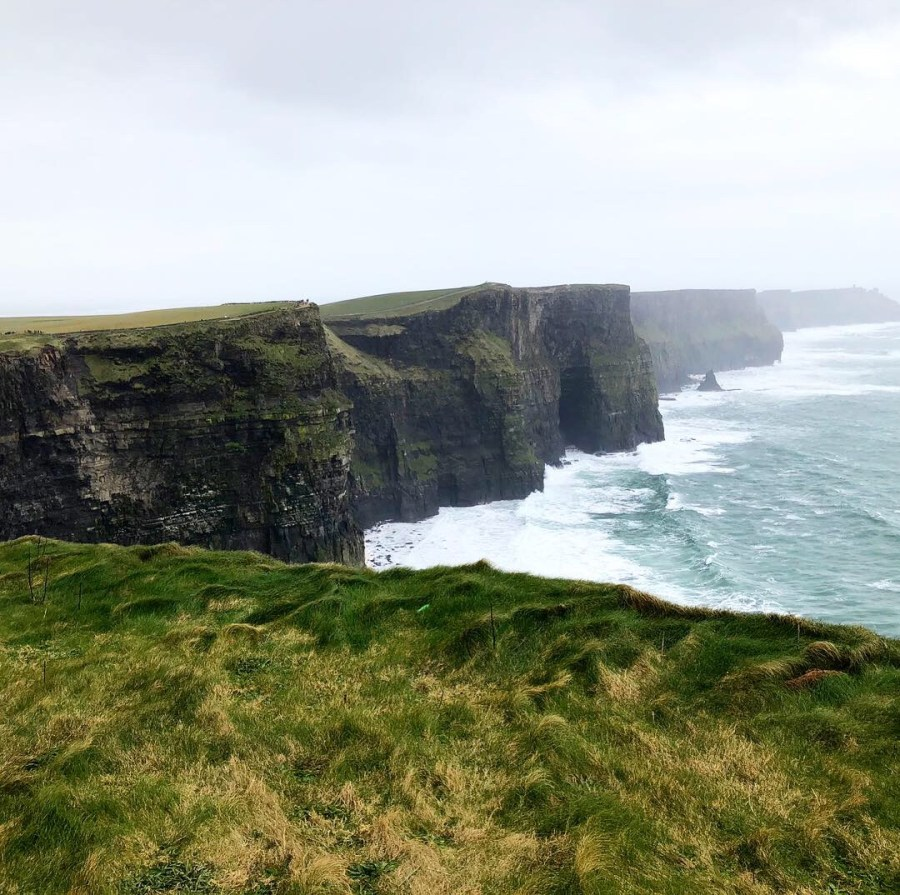 A breathtaking view of the Cliffs of Moher, a must see on your road trip through Ireland! - Adventuresofb2.com