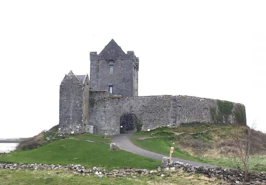 Dunguaire Castle in Ireland is an amazing stop on your road trip through Ireland. Visit April through October for tours of castle and medieval banquets. - AdventuresofB2.com