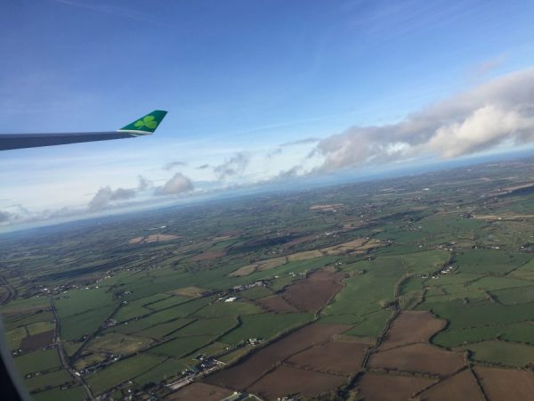 Flying over Ireland on you way home from your Ireland road trip. You can still see how beautiful the country is with all its green pastures- Adventuresofb2.com