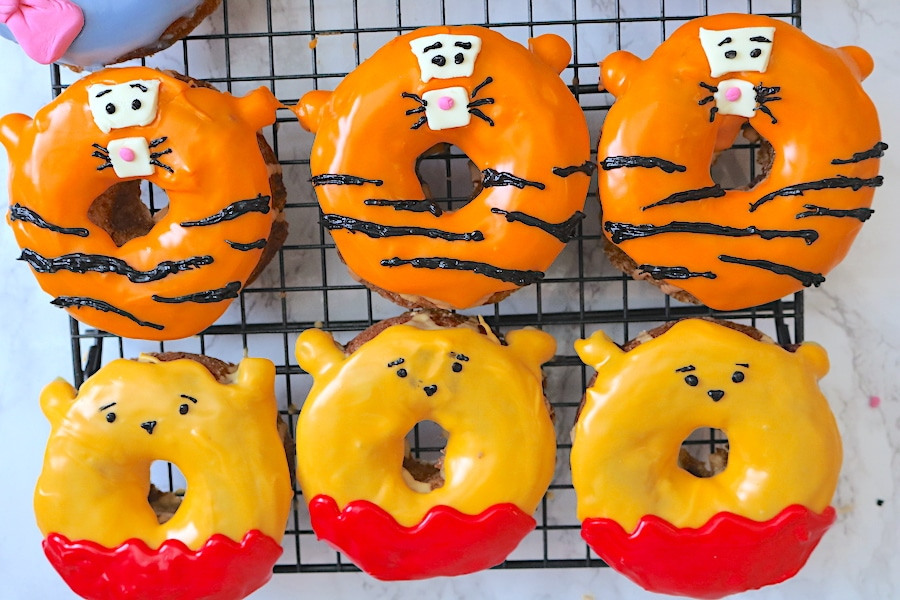 Tigger and Pooh Bear donuts are the most adorable donuts you make! Simple step by step instructions for how to make your own winnie the pooh donuts over at adventuresofb2.com