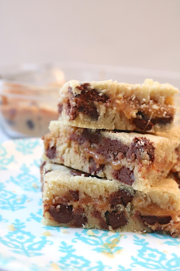 salted caramel chocolate chip cookie bars are rich, gooey and chocolatey. It combines your favorite flavors into one place for the ultimate dessert bar. It's 2 layers of soft chocolate chip cookie dough with a layer of gooey salted caramel for the ultimate treat for any dessert lover. - adventuresofb2.com