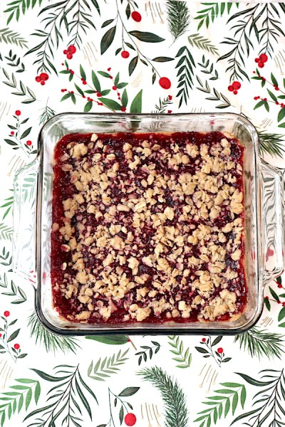 Cranberry Crumble Bars are a fantastic treat this holiday season. A soft shortbread base with a sweet cranberry filling with a oatmeal crumble on top. A delicious snack that is not overly sweet but bursting with cranberry flavor. - adventuresofb2.com