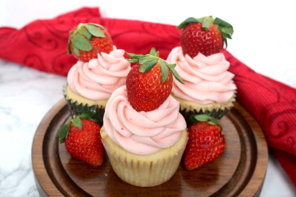 Strawberries and Cream cupcakes are a strawberry lover's dream. Made with a simple vanilla cupcake with a creamy cool whip and strawberry filling topped with a fresh strawberry buttercream! Perfect for Valentine's day or sweet summertime! - Adventures of B2 #strawberry #vanilla #cupcakes #strawberriesandcream #strawberrycupcakes #vanillacupcakes #strawberryfrosting