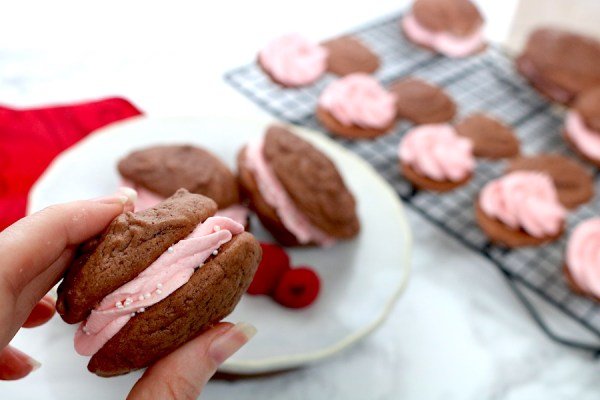 Raspberry Chocolate Sandwich cookies are made with soft chocolate cookies with a fresh raspberry buttercream sandwich in the middle! A easy sweet treat for this valentine's day! - Adventuresofb2.com