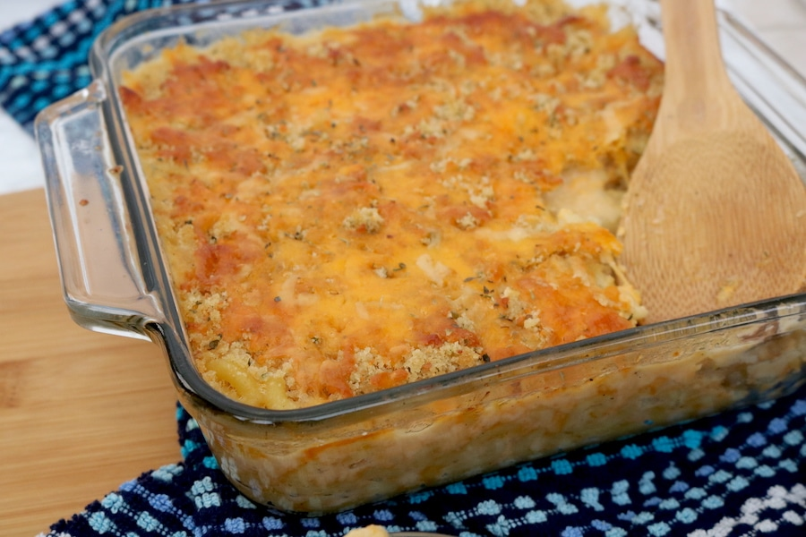 Homemade baked macaroni and cheese is a family favorite and classic with its creamy and gooey cheese covered pasta topped with more cheese and panko crumbs to give it a nice crunch. Kids love it and it's so easy to make especially the crunchy cheesy topping! - adventuresofb2.com
