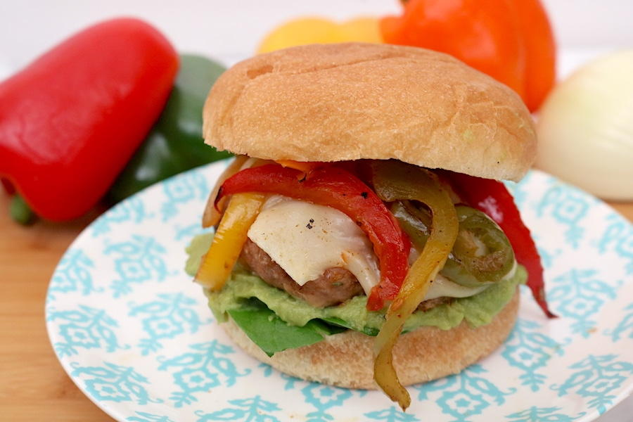 Fajita turkey burgers are great alternative to regular cheeseburgers. They are flavorful, juicy burgers with onions and peppers and options for toppings. - adventuresofb2.com.