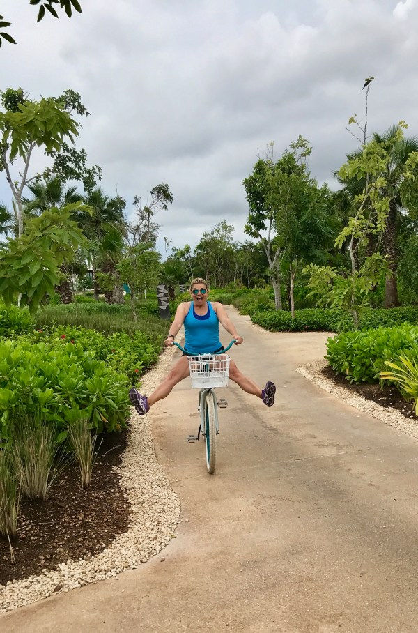 Riding an adorable bike at the Andaz Mayakoba Resort