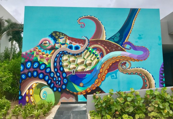 A giant colorful wall mural of an octopus at the Andaz Mayakoba Resort.