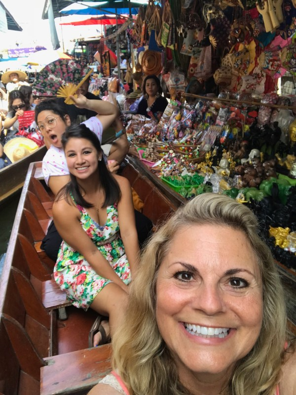 Ten reasons to visit Thailand and sitting in a boat at the floating market.