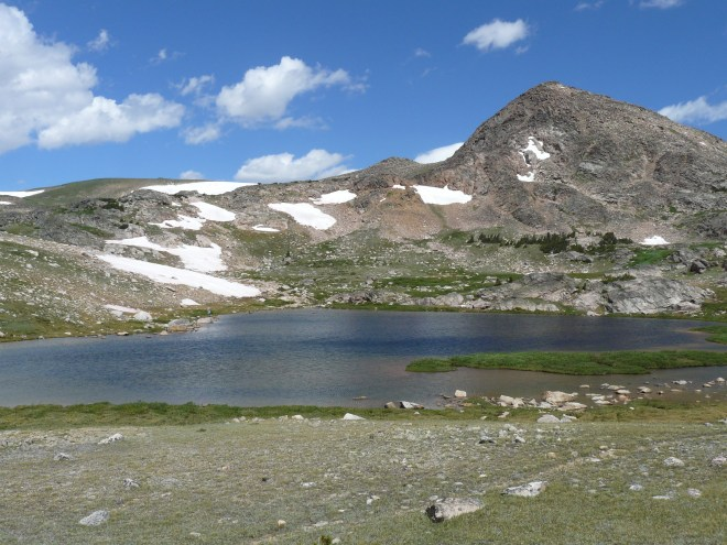 Frozen Lake in the Beartooth Mountains. Photo looks N.