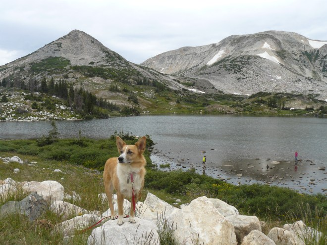 Lupe about to set off from Lewis Lake to climb Sugarloaf Mountain (L). Medicine Bow Peak at (R).