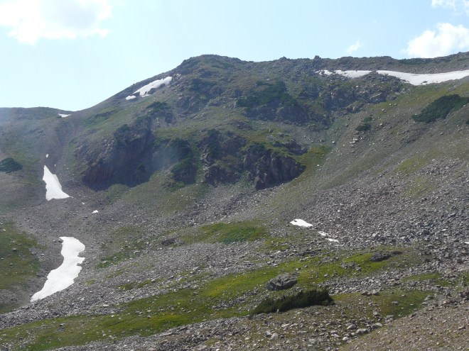 The upper end of the U-shaped valley. High Point 12,006 is at the left end of the ridge. Photo looks W from the Red Dirt Pass Trail.