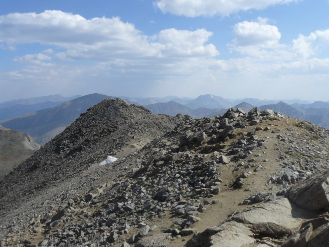 Looking S back along the ridgeline from the summit. Mount Elbert is in the shadow of a cloud at L Center. La Plata Peak is seen just R of Center.