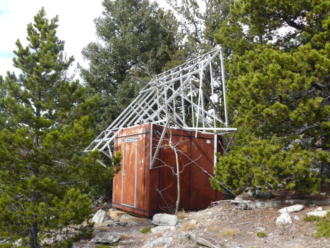 This rusty shed near a little tower on Bergen Peak is just a couple hundred feet S of the summit.