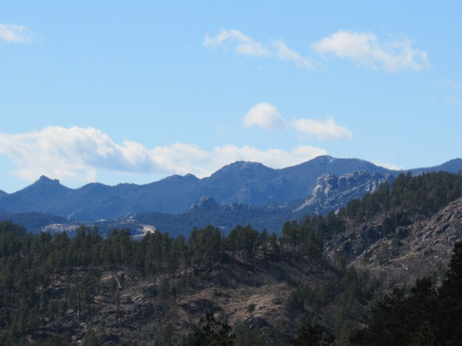 Mt. Rushmore (R) from the high point E of Echo Peak. Photo looks SW using the telephoto lens.