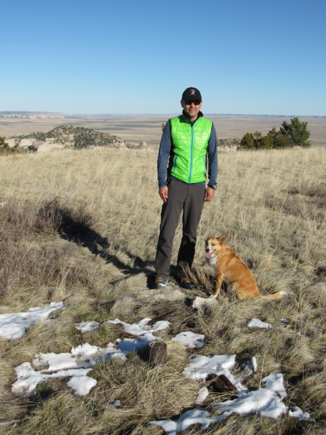 Peakbagging buddies Lupe & Jobe on Wildcat Mountain. The USGS benchmark is seen on the ground in front of Jobe. Photo looks E.
