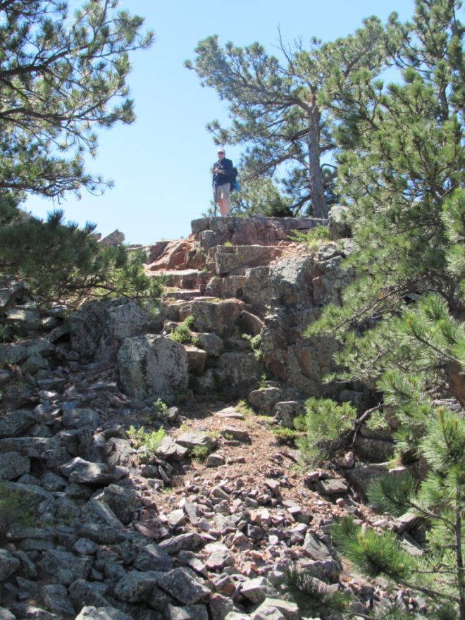 Joe stands near the spot where he had been transmitting from on the N summit. Photo looks S.