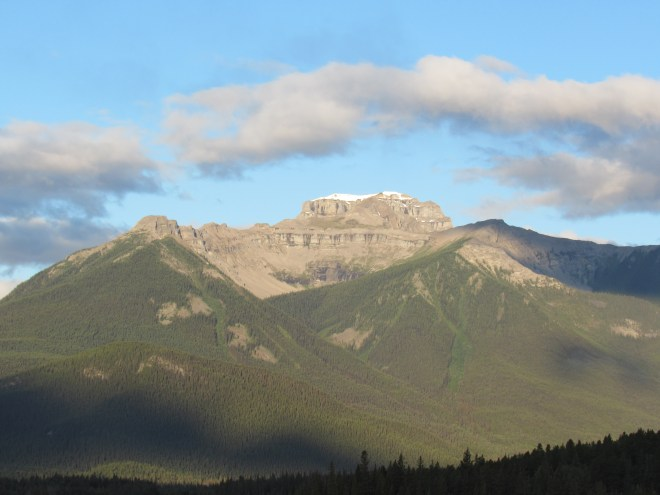 Mount Bourgeau as seen from Trans-Canada Hwy No. 1 a few miles W of Banff. The trail to the top comes up from Harvey Pass on the opposite side. Photo looks WSW.