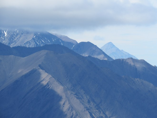 Mount Decoeli is the sharp most distant peak on the R. Decoeli was on the short list of peaks SPHP thought Lupe might be able to climb in Kluane National Park. However, the mountain looked daunting from King's Throne Peak. Photo looks NW using the telephoto lens.