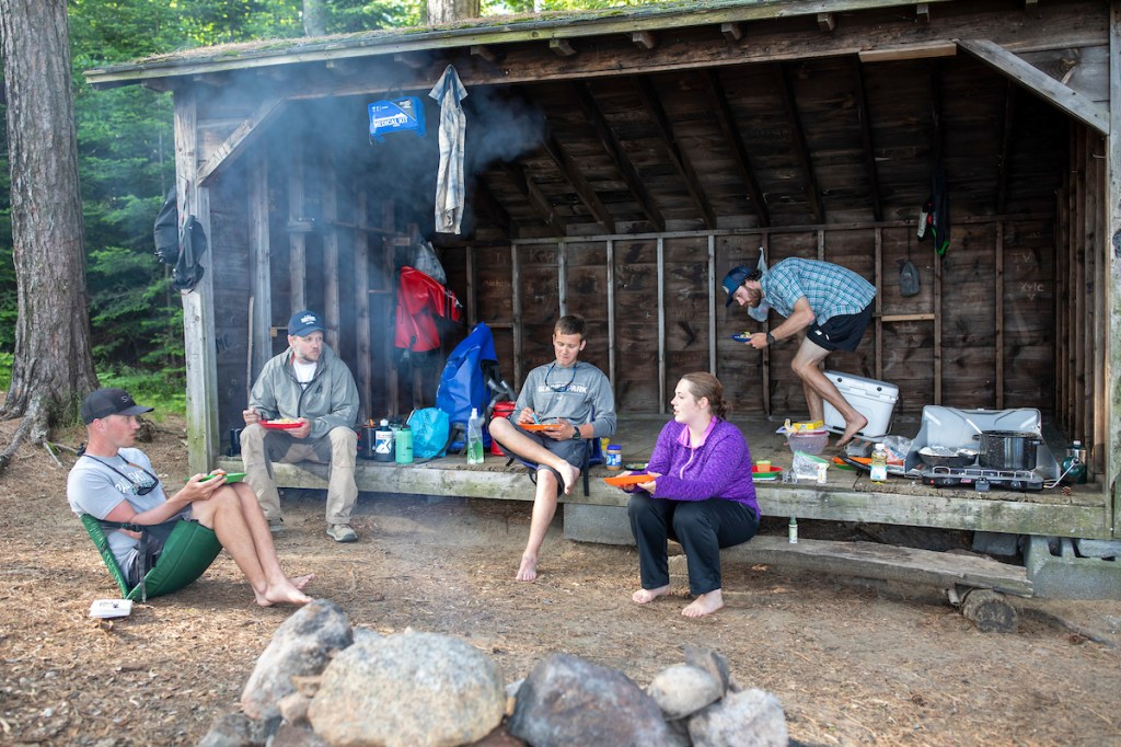 Paul Smith's College student-guides camping at one of the lean-tos on the north side of Long Lake.