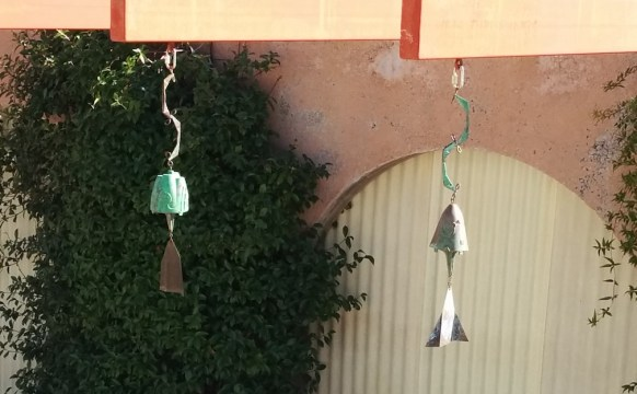 A couple Arcosanti cast windchimes