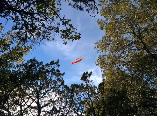 Noisy blimp above campsite