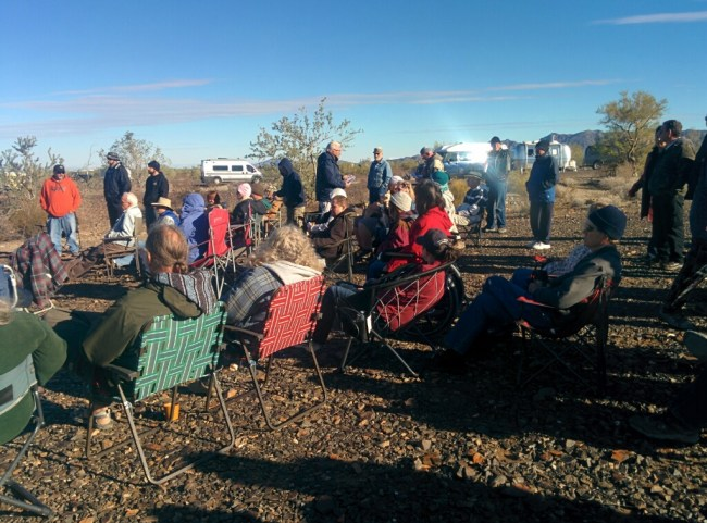 group of people sitting in their camp chairs