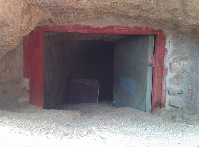 Green Door, Red Frame, Equipment Visible Inside