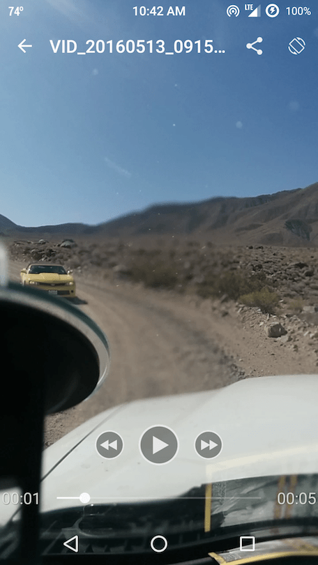 Yellow convertible Camaro on a really rocky, washboarded road