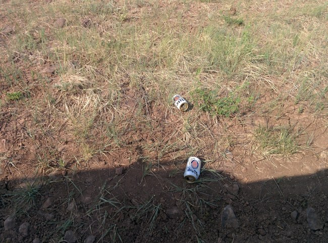 coors lite cans littered on the ground