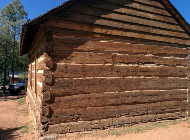 The Rear Of The Schoolhouse With Cleaned Up Area Where a Vandal Left Their Mark Of The Douche