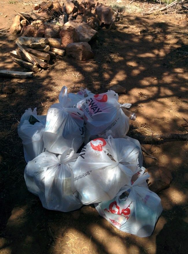 bags of garbage collected from a junky's shooting gallery camp